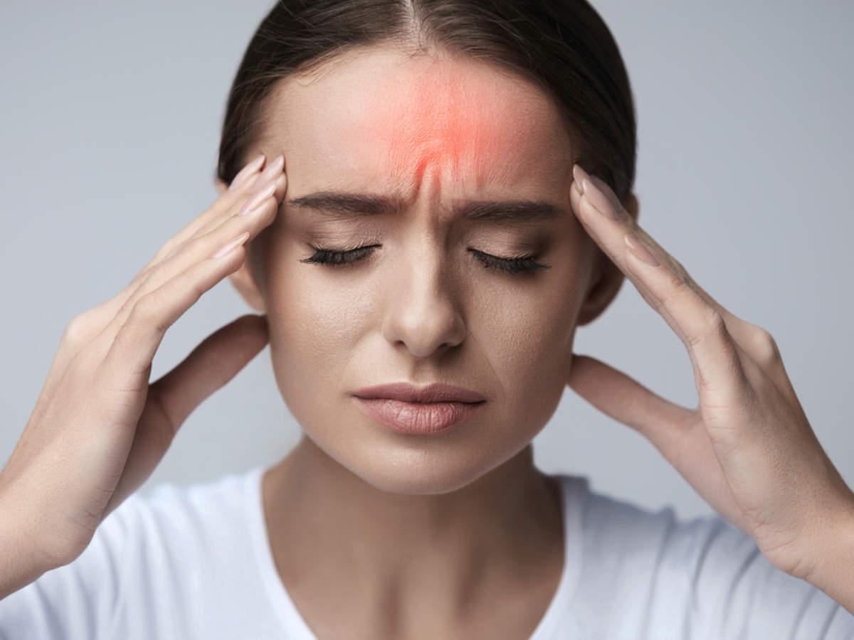 Woman experiencing a Migraine Headache