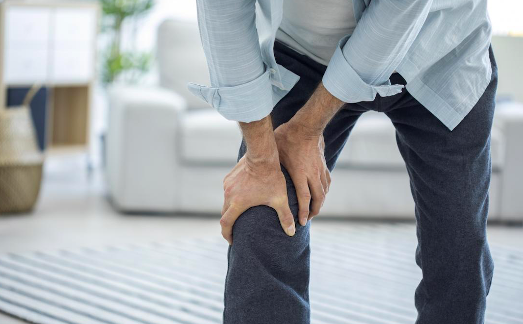 Man holding his leg due to pain