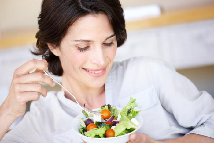 girl holding a bowl of veggies